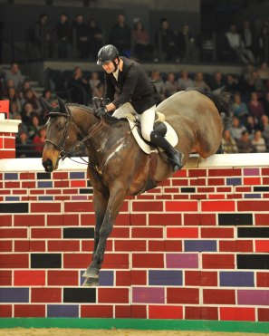 Liverpool Horse Show Day 1 01.01.16 Puissance winner Peter Smyth on Cavalier Rusticana