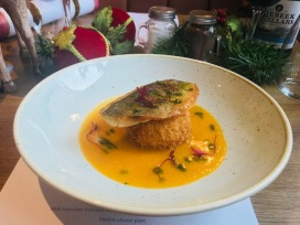 Pan fried sea bream, lemongrass and red pepper risotto cake, sweet potato broth