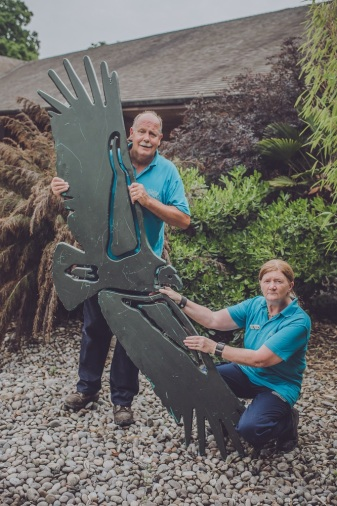 Chester Zoo is auctioning off 500 pieces of zoo history on eBay. Andy Woolham and Anne Morris, stars of The Secret Life of the Zoo, show off a giant condor model (1)