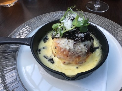 Twice baked Collier's Welsh cheddar with black truffle and sticky shallots