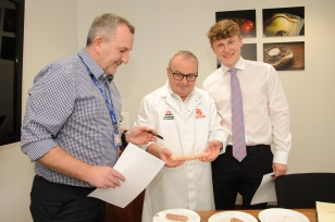 University of Chester Now Food Centre, judging of the traditional and flavered sausage competition, for the Chester Food, Drink and Lifestyle Festival. Picture judging Jeff George of the University of Chester Now Food Centre Manager, Champion sausage and Butcher Stephen Vaughan of Vaughan's Butchers Pen y Ffordd and Harry Bosse of Bosse Inter Spice Spncers of National Sausage Week. SW26219F